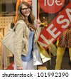Sale: Young and happy woman shopping - stock photo