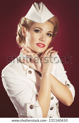 Sales - fashion blonde woman Pin-up girl in retro vintage dress in romantic pose. Sexy Patriotic American Girl shopper Classy and Trendy Woman in Pin Up Style Shopping Mall Sales and Discounts Concept - stock photo