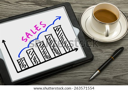 sales graph concept hand drawing on tablet pc - stock photo