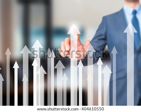 Sales Growth Graph - Businessman hand pressing button on touch screen interface. Business, technology, internet concept. Stock Photo - stock photo