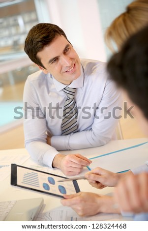 Sales manager meeting with business partners - stock photo