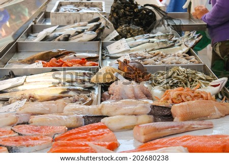 Sales of fresh fish on the market  - stock photo