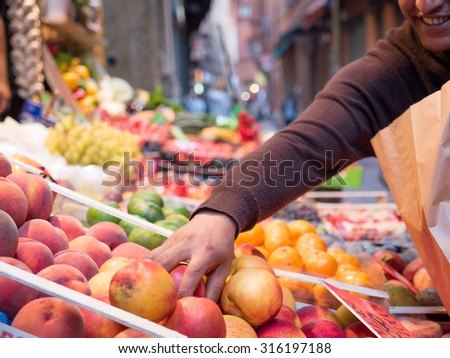 Sales of fruit and vegetables in the center of Bologna, Italy.