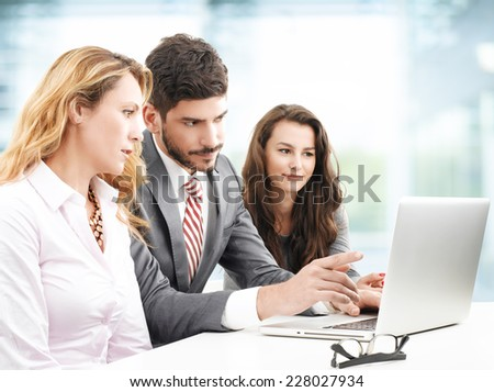 Sales people working on presentation at laptop. Teamwork.  - stock photo