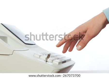 Sales persons hand  going to enter amount on cash register in retail store . Isolated on white.