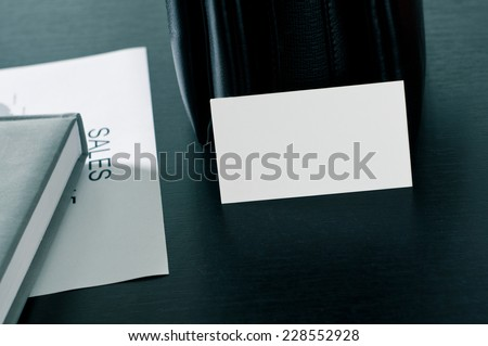 sales plan with a business card and luxury on the table. - stock photo