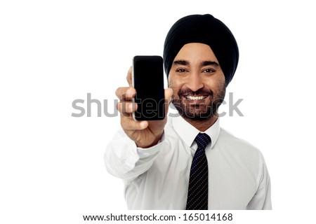 Sales representative displaying stylish cellphone - stock photo