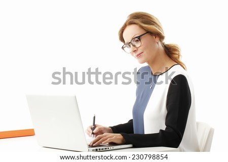 Sales woman analyzing data while sitting at desk at laptop. Isolated on white background.  - stock photo