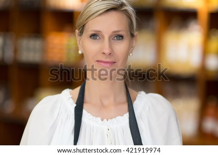 sales woman in grocery store - stock photo