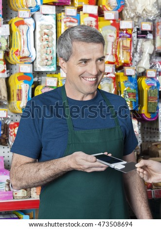 Salesman Accepting Credit Card Payment From Customer