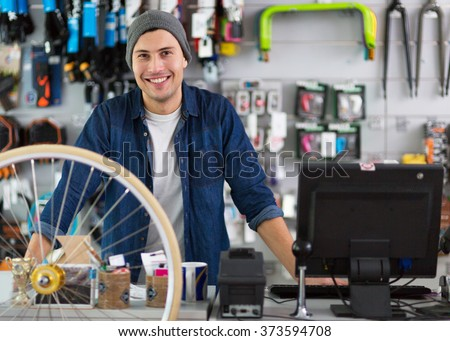 Salesman in bicycle shop