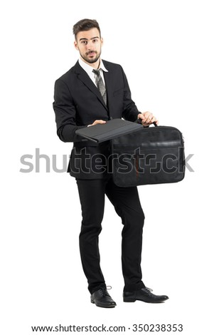 Salesman offering contract looking at camera. Full body length portrait isolated over white studio background.