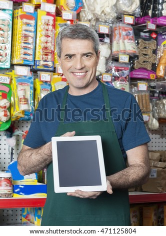 Salesman Showing Digital Tablet With Blank Screen In Pet Store