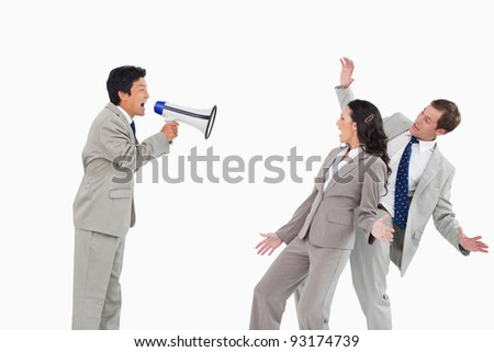 Salesman with megaphone yelling at colleagues against a white background - stock photo