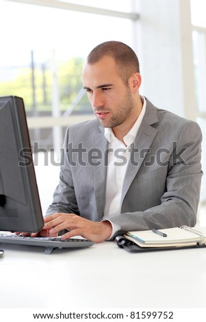 Salesman working on desktop computer