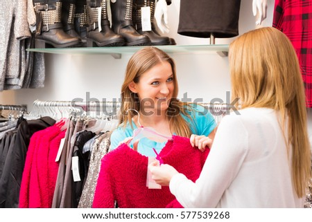 Salesperson Talking To Customers