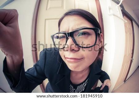 Saleswoman knocking  doors - stock photo