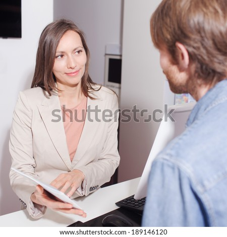 Saleswoman showing a contract