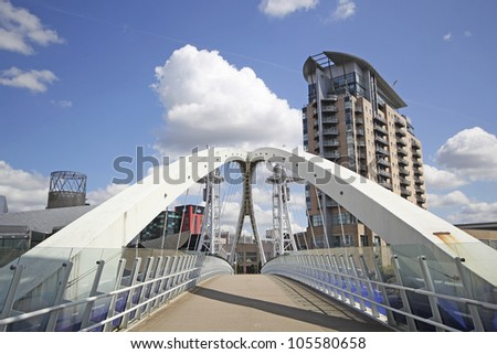 SALFORD QUAYS - JUNE 19: The Millennium Bridge spanning the Manchester Ship Canal, June 19, 2012. Future plans aim to spread the success of Salford Quays' regeneration into other parts of Salford
