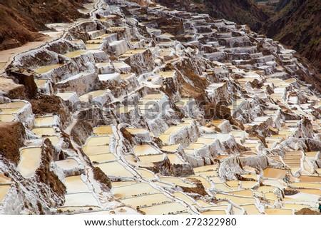 Salina de Maras, the traditional inca salt field in Maras near Cuzco in Sacred Valley, Peru - stock photo