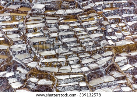 Salinas de Maras is Inca salt pans at Maras village near Cuzco in Sacred Valley, Peru - stock photo