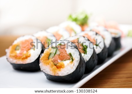 Salmon and caviar rolls served on a plate - stock photo