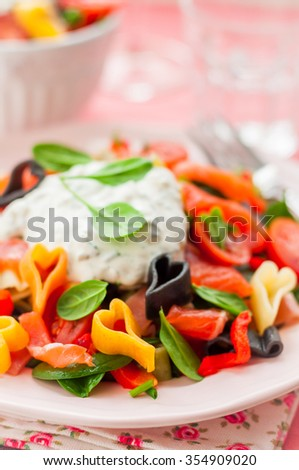 Salmon and Heart Shaped Pasta Salad with Creamy Dressing for Valentine's Day, close up, copy space for your text