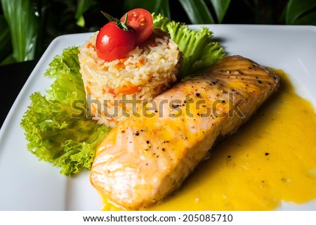 Salmon and Pilaf with the tomato - stock photo