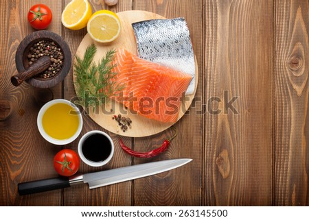 Salmon and spices on wooden table. Top view with copy space - stock photo