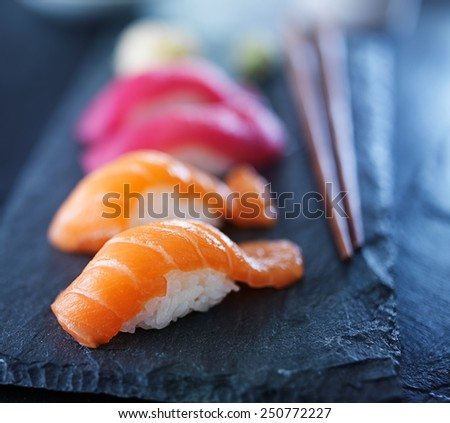 salmon and tuna sushi on slate