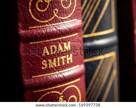 SALMON ARM, CANADA � DECEMBER 27, 2013: Close up of leather bound book spine showing author's name of Adam Smith a Scottish philosopher and economist - stock photo