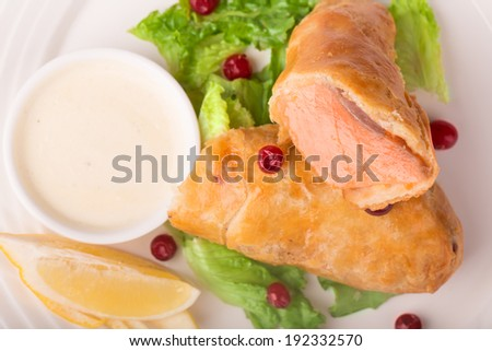 Salmon baked in a batter with cranberries