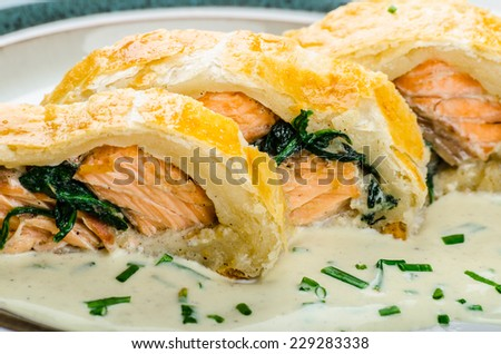 Salmon baked in puff pastry with spinach and garlic