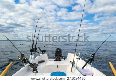 Salmon Baltic sea fishing from small boat - stock photo