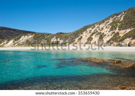 Salmon Beach Bay in Torndirrup National Park near Albany, Western Australia, burnt vegetation on cliff coast, turquoise Southern Oean, blue sky, copy space. - stock photo