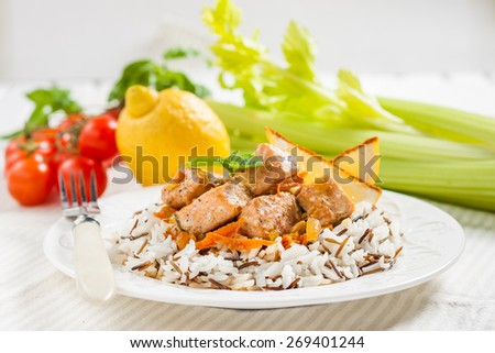 salmon, braised with onions, carrots and celery with a garnish of basmati and wild rice - stock photo