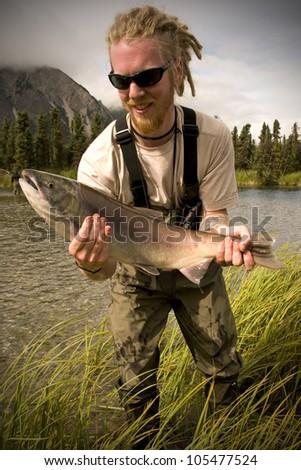 Salmon Catch on Kijik Lake near Lake Clark National Park, Alaska (MRA) - stock photo
