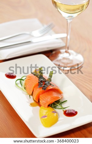 Salmon fillet decorated on a white plate