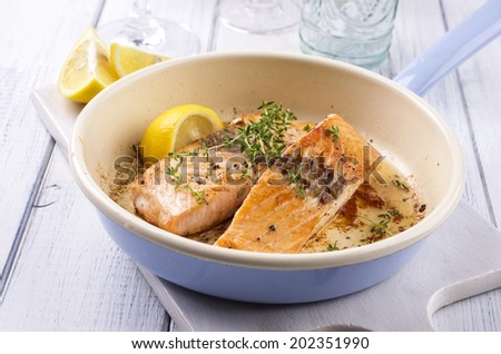 salmon fillet fried in a pan - stock photo