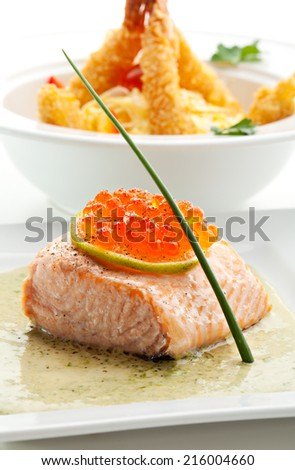 Salmon Fillet in Cream Sauce with Salmon Roe - stock photo