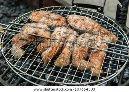 salmon fillet steak on the grill with smoke