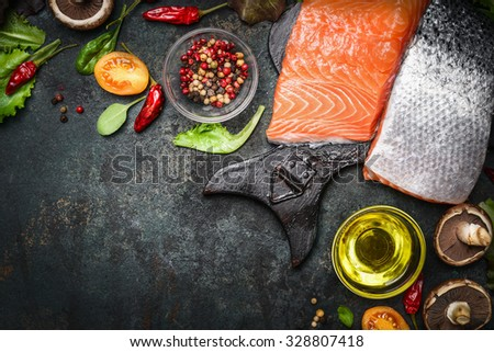 Salmon fillet with delicious ingredients for cooking on dark rustic wooden background, top view, frame. Healthy, diet or vegetarian food concept. - stock photo