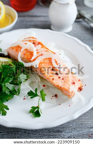 Salmon Fillet with lemon and parsley, food close up