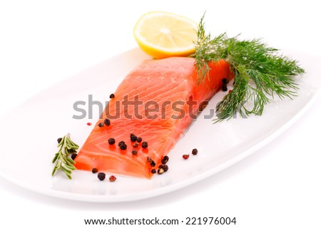 Salmon fillet with lemon, dill on plate isolated on white background. - stock photo