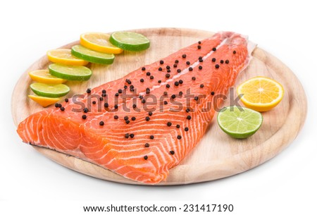 Salmon fillet with pepper and citrus. Isolated on a white background. - stock photo