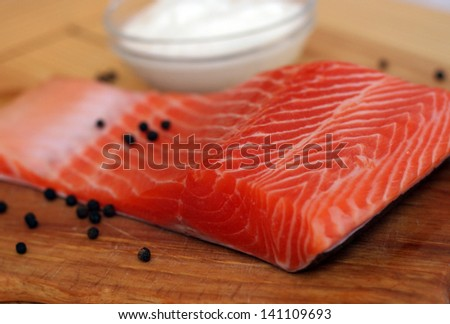 salmon fillet with pepper on a wooden board