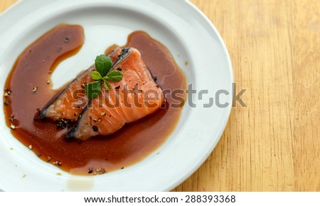 salmon fillet with sauce  - stock photo