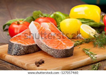 Salmon  fillet with the vegetables  and lemon - stock photo