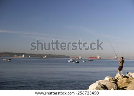 Salmon fishing at English Bay, Vancouver British Columbia, Canada - stock photo
