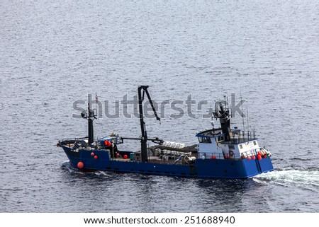 Salmon fishing boat setting out on Tongass Narrows at Ketchikan - stock photo